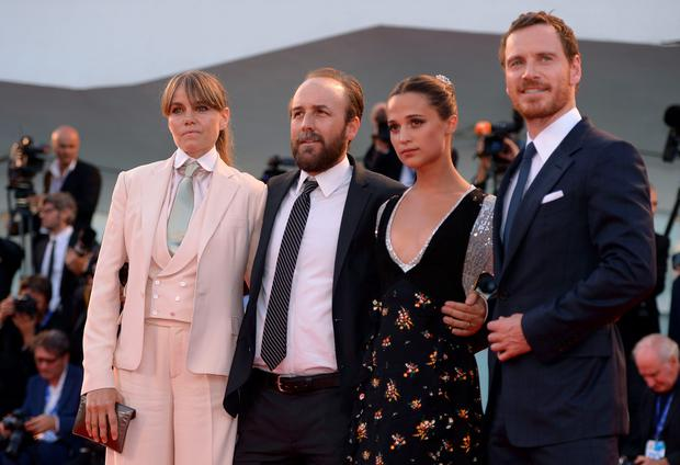 "British actor Michael Fassbender (R) and Swedish actress Alicia Vikander (2ndR) pose with director Derek Cianfrance (2ndL) on the red carpet before the premiere of the movie ""The Light Between Oceans"" presented in competition at the 73rd Venice Film Festival on September 1, 2016 at Venice Lido. / AFP PHOTO / FILIPPO MONTEFORTEFILIPPO MONTEFORTE/AFP/Getty Images"