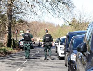 Police on patrol and leaving leaflets for drivers who parked cars at Shaw's Bridge despite car park closures and advice to stay at home to prevent the spread of coronavirus. Photo Pacemaker Press