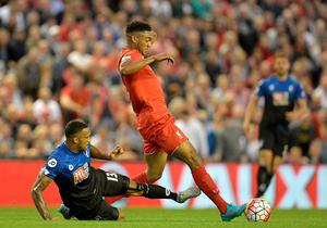Liverpool's English defender Joe Gomez (2nd L) is challenged by Bournemouth's English striker Callum Wilson (L) during the English Premier League football match between Liverpool and Bournemouth at the Anfield stadium in Liverpool, north-west England on August 17, 2015. AFP PHOTO / OLI SCARFF  RESTRICTED TO EDITORIAL USE. No use with unauthorized audio, video, data, fixture lists, club/league logos or 'live' services. Online in-match use limited to 75 images, no video emulation. No use in betting, games or single club/league/player publications.OLI SCARFF/AFP/Getty Images