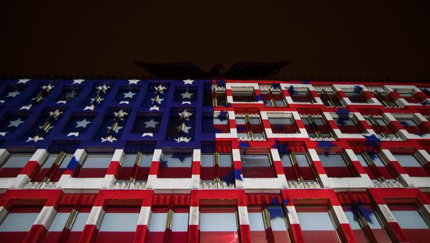 LONDON, ENGLAND - NOVEMBER 08: The American flag is projected on to the United States Embassy during an election night party on November 8, 2016 in London, England. Americans have gone to the polls today, November 8, to elect the 45th President of the United States. Hillary Clinton represents the Democrats and, if successful, would be the first woman president in American history.  Donald Trump represents the Republicans and his campaign has been dogged by bad publicity, despite this the polls show that either of the two contenders could win with the election too close to call. (Photo by Jack Taylor/Getty Images)