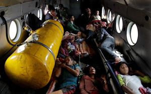 Nepalese victims of Saturdays earthquake lie inside an Indian air force helicopter as they are evacuated from Trishuli Bazar to Kathmandu airport in Nepal, Monday, April 27, 2015. The death toll from Nepal's earthquake is expected to rise depended largely on the condition of vulnerable mountain villages that rescue workers were still struggling to reach two days after the disaster.  (AP Photo/Altaf Qadri)