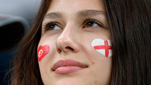 A fan sporting Tunisia and England flags painted on her face awaits the start of the Russia 2018 World Cup Group G football match between Tunisia and England at the Volgograd Arena in Volgograd on June 18, 2018. / AFP PHOTO / Philippe DESMAZES / RESTRICTED TO EDITORIAL USE - NO MOBILE PUSH ALERTS/DOWNLOADSPHILIPPE DESMAZES/AFP/Getty Images