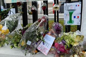 Messages and flowers are seen in tribute to the victims of Paris attacks outside the French Embassy in Singapore on November 16, 2015. Islamic State jihadists claimed a series of coordinated attacks by gunmen and suicide bombers in Paris on November 13 that killed at least 129 people in scenes of carnage at a concert hall, restaurants and the national stadium. AFP PHOTO / ROSLAN RAHMANROSLAN RAHMAN/AFP/Getty Images