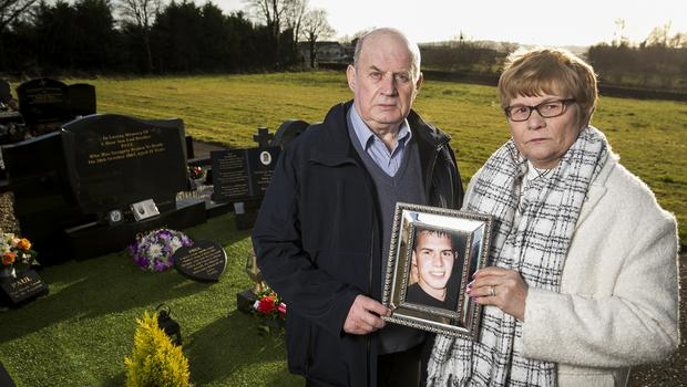 Stephen and Breege Quinn at their son Paul's graveside (Liam McBurney/PA)