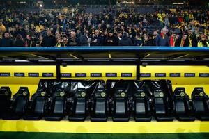 Dortmund's empty bench is seen after the team bus of Borussia Dortmund had some windows broken by an explosion some 10km away from the stadium prior to the UEFA Champions League 1st leg quarter-final football match BVB Borussia Dortmund v Monaco in Dortmund, western Germany on April 11, 2017. / AFP PHOTO / Odd ANDERSENODD ANDERSEN/AFP/Getty Images
