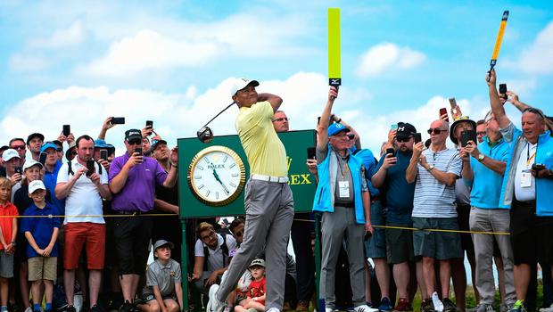 US golfer Tiger Woods tees off from the 16th hole during a practice session at The 148th Open golf Championship at Royal Portrush golf club in Northern Ireland on July 15, 2019. (Photo by Andy Buchanan / AFP) / RESTRICTED TO EDITORIAL USEANDY BUCHANAN/AFP/Getty Images