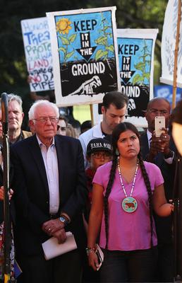 U.S. Sen. Bernie Sanders (I-VT) (L) waits to be introduced during a rally against the Dakota Access Pipeline September 13, 2016 at Lafayette Square in Washington, DC. Activists held a rally calling on President Barack Obama to stop the Dakota Access Pipeline.  (Photo by Alex Wong/Getty Images)