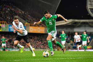 BELFAST, NORTHERN IRELAND - MARCH 21:  Jordan Jones of Northern Ireland runs with the ball during the 2020 UEFA European Championships group C qualifying match between Northern Ireland and Estonia at Windsor Park on March 21, 2019 in Belfast, United Kingdom. (Photo by Charles McQuillan/Getty Images)