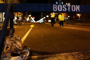 BOSTON, MA - APRIL 16:  A piece of debris rests against a police barricade near the scene of a twin bombing at the Boston Marathon, on April 16, 2013 in Boston, Massachusetts. Three people are confirmed dead and at least 141 injured after the explosions went off near the finish line of the marathon yesterday. The bombings at the 116-year-old Boston race, resulted in heightened security across the nation with cancellations of many professional sporting events as authorities search for a motive to the violence. (Photo by Spencer Platt/Getty Images)