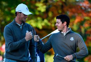 CHASKA, MN - OCTOBER 01:  Thomas Pieters and Rory McIlroy of Europe react on the fourth green during morning foursome matches of the 2016 Ryder Cup at Hazeltine National Golf Club on October 1, 2016 in Chaska, Minnesota.  (Photo by Ross Kinnaird/Getty Images)