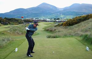 NEWCASTLE, NORTHERN IRELAND - MAY 29:  Rickie Fowler of the United States tees off on the 16th hole during the Second Round of the Dubai Duty Free Irish Open Hosted by the Rory Foundation at Royal County Down Golf Club on May 29, 2015 in Newcastle, Northern Ireland.  (Photo by Andrew Redington/Getty Images)