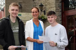 Mandatory Credit - Picture by Freddie Parkinson/Press Eye © Thursday 15 August 2019 Ballyclare High School A Level Results on the increase once again in Ballyclare High School. Dr Michelle Rainey Principal (Centre) with Jack Bartley 2A* and A and Luke Nugent 2A* and A