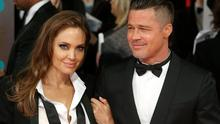 Actors Angelina Jolie and Brad Pitt attend the EE British Academy Film Awards 2014 at The Royal Opera House