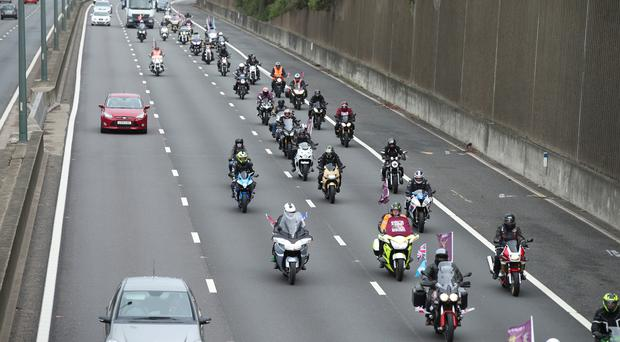 A convoy of motorbikes drive along the M1 motorway towards central London as part of a 'Rolling Thunder' protest for Soldier F (Yui Mok/PA)