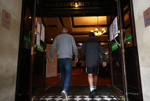 Customers walk into the Shakespeare's Head pub in Holborn, London, as it reopens (Yui Mok/PA)