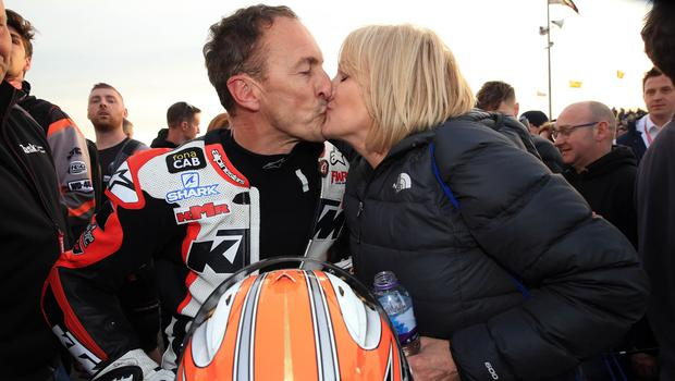 PACEMAKER BELFAST  17/05/2018 North West 200 2018 Jeremy McWilliams gets a kiss from wife Jill during this evenings Supertwin race in the Vauxhall International North West 200. Photo Stephen Davison/Pacemaker Press
