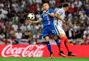 Iceland's defender Ari Skulason (L) vies for the ball against England's defender Kyle Walker during Euro 2016 round of 16 football match between England and Iceland at the Allianz Riviera stadium in Nice on June 27, 2016.   / AFP PHOTO / TOBIAS SCHWARZTOBIAS SCHWARZ/AFP/Getty Images