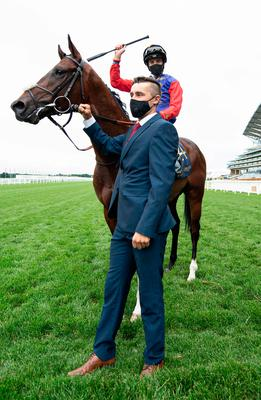 Doyle wearing the Queen's silks on Tactical and celebrating after winning The Windsor Castle Stakes
