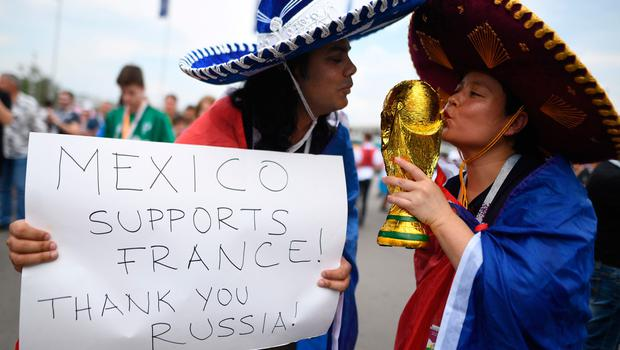 France's supporters pose ahead of the Russia 2018 World Cup final football match between France and Croatia at the Luzhniki Stadium in Moscow on July 15, 2018. / AFP PHOTO / Kirill KUDRYAVTSEVKIRILL KUDRYAVTSEV/AFP/Getty Images