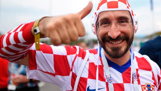 A Croatia's supporter poses ahead of the Russia 2018 World Cup final football match between France and Croatia at the Luzhniki Stadium in Moscow on July 15, 2018. / AFP PHOTO / Kirill KUDRYAVTSEVKIRILL KUDRYAVTSEV/AFP/Getty Images