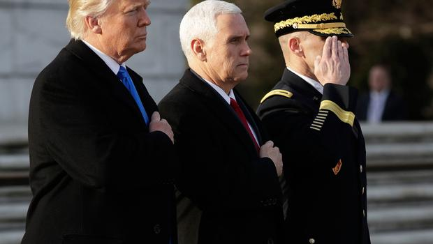 President-elect Donald Trump, accompanied by Vice President-elect Mike Pence pauses after placing a wreath at the Tomb of the Unknowns, Thursday, Jan. 19, 2017, at Arlington National Cemetery in Arlington, Va., ahead of Friday's presidential inauguration. (AP Photo/Evan Vucci)