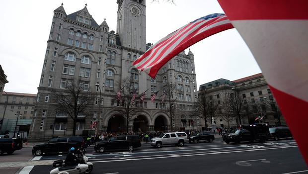 The motorcade of US President-elect Donald Trump is parked in front of the Trump International Hotel as he attends a leadership luncheon in Washington, DC on January 19, 2017.  Twenty-four hours before he takes the oath of office as the 45th US president, Donald Trump arrived in Washington , determined to transform American politics over the next four years. / AFP PHOTO / Robyn BECKROBYN BECK/AFP/Getty Images