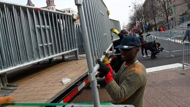Baracades are installed ahead of the inaugural parade of US President-elect Donald Trump, in Washington, DC on January 19, 2017.  Twenty-four hours before he takes the oath of office as the 45th US president, Donald Trump arrived in Washington , determined to transform American politics over the next four years. / AFP PHOTO / Robyn BECKROBYN BECK/AFP/Getty Images