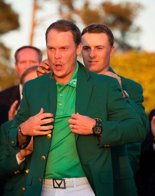 US golfer Jordan Spieth presents the Green Jacket to England's Danny Willett at the end of the 80th Masters Golf Tournament at the Augusta National Golf Club on April 10, 2016, in Augusta, Georgia. England's Danny Willett won the 80th Masters at Augusta National on Sunday for his first major title. He was trailing defending champion Jordan Spieth by five strokes around the turn, but stormed down the back nine to overhaul the American. Willett is the first Englishman since Nick Faldo 20 years ago to win the Masters and only the second all-time. / AFP PHOTO / Jim WatsonJIM WATSON/AFP/Getty Images