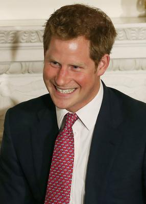 WASHINGTON, DC - MAY 09:  HRH Prince Harry smiles while attending an event hosted by first lady Michelle Obama to honor military families at the White House on May 9, 2013 in Washington, DC. HRH will be undertaking engagements on behalf of charities with which the Prince is closely associated on behalf also of HM Government, with a central theme of supporting injured service personnel from the UK and US forces.  (Photo by Mark Wilson/Getty Images)