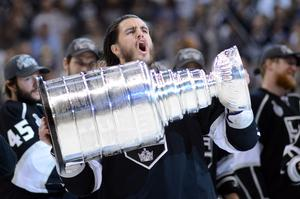 Seen it all: Kevin Westgarth lifts the Stanley Cup in 2012 but now happy to find employment with Belfast Giants
