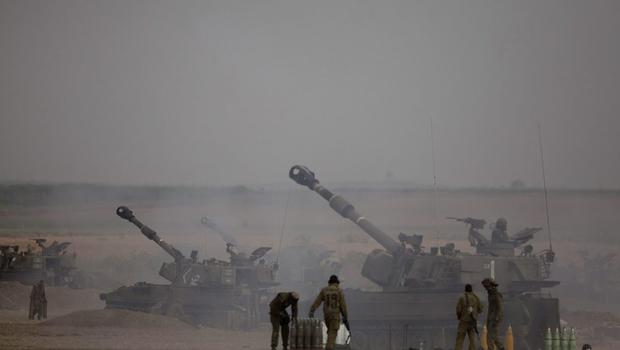 Israeli artillery cannons fire a shell on July 20, 2014 at the Israeli-Gaza border. Protests have taken place all around the world against Israel's action in Gaza as the IDF have announced that they plan to expand their ground offensive.   (Photo by Lior Mizrahi/Getty Images)