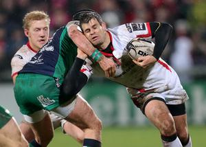 Tough going: Ulster's Louis Ludik is tackled by Connacht's Dave McSharry during last night's game
