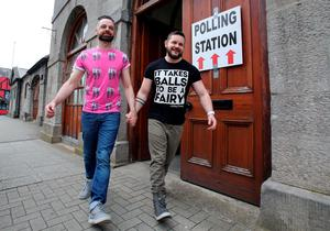 A gay couple pose holding hands as they walk out of a polling station after voting in Drogheda, north Dublin on May 22, 2015. Ireland took to the polls today to vote on whether same-sex marriage should be legal, in a referendum that has exposed sharp divisions between communities in this traditionally Catholic nation.   AFP PHOTO / Paul FaithPAUL FAITH/AFP/Getty Images