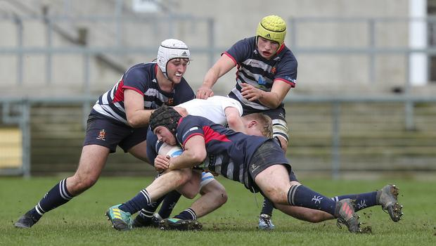 Wednesday 6th March 2019 | Ulster Schools Cup - Semi Final 2  Ben Gourley is tacked by Harry Long, Ben Carson and Reuben Crothers during the Ulster Schools Cup semi-final between MCB and Wallace High School at Kingspan Stadium, Ravenhill Park, Belfast, Northern Ireland. Photo by John Dickson / DICKSONDIGITAL
