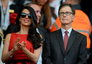 Liverpool's US owner John W. Henry (R) and his wife Linda Pizzuti are pictured before the start of the English Premier League football match between Liverpool and Bournemouth at the Anfield stadium in Liverpool, north-west England on August 17, 2015.  AFP PHOTO / OLI SCARFF  RESTRICTED TO EDITORIAL USE. No use with unauthorized audio, video, data, fixture lists, club/league logos or 'live' services. Online in-match use limited to 75 images, no video emulation. No use in betting, games or single club/league/player publications.OLI SCARFF/AFP/Getty Images