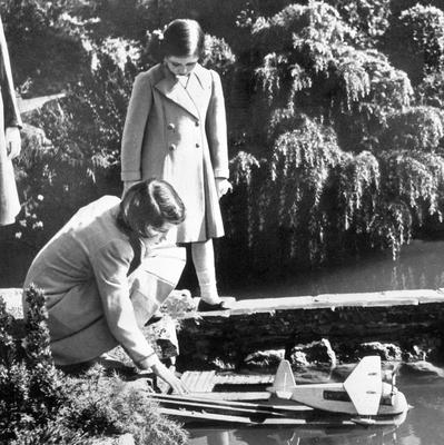 File photo dated 01/04/1939 of Princesses Elizabeth (now Queen Elizabeth II) and Margaret launching a model seaplane at the Bekonscot model village in Beaconsfield, Buckinghamshire as the Queen turns 90 on the April 21st. PRESS ASSOCIATION Photo. Issue date: Sunday April 3, 2016. See PA story ROYAL Birthday. Photo credit should read: PA Wire