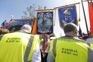 Press Eye - Belfast -  Saturday 20th July 2013   Orange protestors and marshalls pictured on the Woodvale Road in Belfast afternoon attempt to parade up to the police lines.  In an unexpected move earlier this week, Orangemen made a new application to the Parades Commission adjudication body to march the disputed Crumlin Road section of the route today. That bid was again rejected by the commission - a move that is likely to prompt another stand-off between police and protesters at the same community interface area later.  The Order said it applied for Saturday's event to complete a return parade they were banned from making on the Twelfth of July.  Order members have continued to hold protests in the area throughout the week.  Picture by Kelvin Boyes / Press Eye.