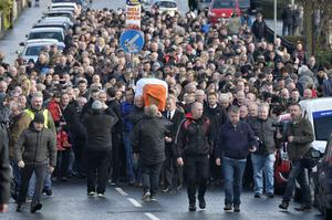 Mourners pictured at the removal of Sinn Feins Martin McGuinness to his home in the Bog side. Photo by Stephen Hamilton / Press Eye.