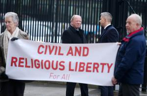 Press Eye - Belfast - Northern Ireland -14th December 2015  Pastor James McConnell(left) arrives at Belfast's legalised Court where his trail begins regarding comments he made about Islam in one of his church sermons.  TUV leader Jim Allister(centre) arrives at the court.   Picture by Jonathan Porter/PressEye