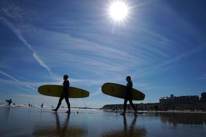 The sunshine finally returned as the August bank holiday weekend drew to a close, with surfers taking to the water at Long Sands Beach, Tynemouth (Owen Humphreys/PA)