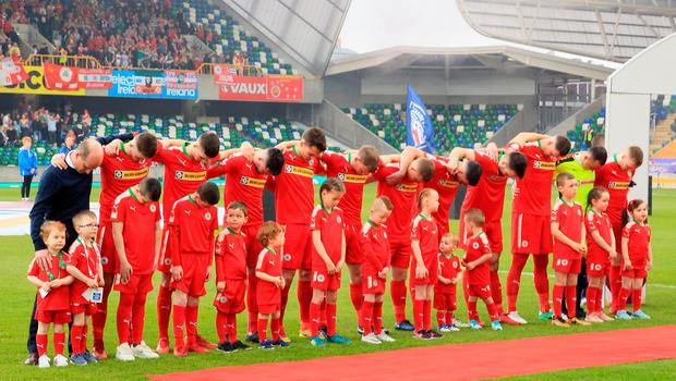 On the day Reds fans roared their disapproval as the anthem was blasted out over the tannoy system while Barry Gray and his players bowed their heads in silent protest
