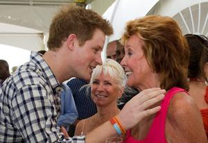 Prince Harry meets Cilla Black before playing in the inaugural Setebale Polo Cup at the Apes Hill polo club on January 31, 2010 in Apes Hill, Barbados.  (Photo by Arthur Edwards/WPA Pool/Getty Images)