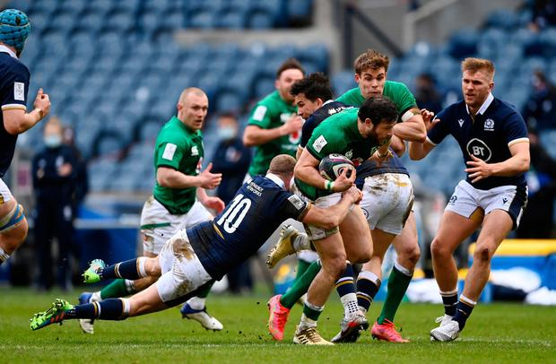 Ireland try scorer Robbie Henshaw breaks through the tackle of Scotland fly-half Finn Russell (Stu Forster/Getty Images)