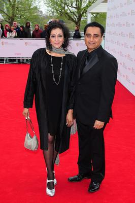Meera Syal (left) and Sanjeev Bhaskar  arriving for the 2013 Arqiva British Academy Television Awards at the Royal Festival Hall, London. PRESS ASSOCIATION Photo. Picture date: Sunday May 12, 2013. See PA story SHOWBIZ Bafta. Photo credit should read: Ian West/PA Wire
