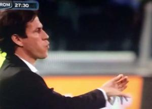 Roma manager Rudi Garcia playing what appears to be an imaginary violin