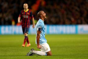 Manchester City's Vincent Kompany reacts after a decision goes against him during the UEFA Champions League, Round of 16 match at the Etihad Stadium, Manchester. PRESS ASSOCIATION Photo. Picture date: Tuesday February 18, 2014. See PA story SOCCER Man City. Photo credit should read: Peter Byrne/PA Wire