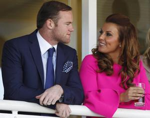 Coleen Rooney with footballer husband Wayne (Dave Thompson/PA)