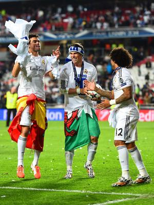 LISBON, PORTUGAL - MAY 24:  Pepe, Gareth Bale and Marcelo of Real Madrid celebrate victory after the UEFA Champions League Final between Real Madrid and Atletico de Madrid at Estadio da Luz on May 24, 2014 in Lisbon, Portugal.  (Photo by Laurence Griffiths/Getty Images)