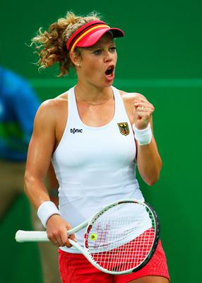 RIO DE JANEIRO, BRAZIL - AUGUST 08:  Laura Siegemund of Germany celebrates during the Women's Singles second round match against Shuai Zhang of China on Day 3 of the Rio 2016 Olympic Games at the Olympic Tennis Centre on August 8, 2016 in Rio de Janeiro, Brazil.  (Photo by Clive Brunskill/Getty Images)
