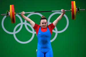 Chile's Maria Fernanda Valdes Paris competes during the women's weightlifting 75kg event during the Rio 2016 Olympics Games in Rio de Janeiro on August 12, 2016. / AFP PHOTO / GOH Chai HinGOH CHAI HIN/AFP/Getty Images